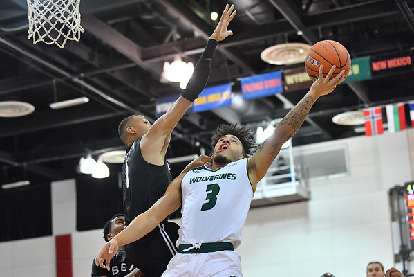 LAS VEGAS, NV - NOVEMBER 21:  TJ Washington #3 of the Utah Valley Wolverines shoots against the Long Beach State 49ers during the middleweight bracket championship game of the MGM Resorts Main Event at Cox Pavilion in Las Vegas, Nevada.  (Photo by Sam Wasson for Iona Athletics)