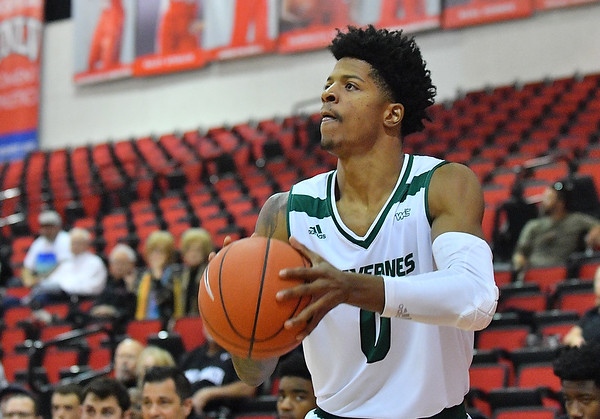 LAS VEGAS, NV - NOVEMBER 21:  Isaiah White #0 of the Utah Valley Wolverines shoots against the Long Beach State 49ers during the middleweight bracket championship game of the MGM Resorts Main Event at Cox Pavilion in Las Vegas, Nevada.  (Photo by Sam Wasson for Iona Athletics)