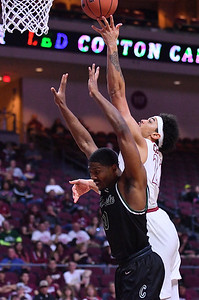 LAS VEGAS, NV - MARCH 08:  Eli Chuha #22 of the New Mexico State Aggies drives in for a layup against Glen Burns #0 of the Chicago State Cougars during a quarterfinal game of the Western Athletic Conference basketball tournament at the Orleans Arena in Las Vegas, Nevada. The Aggies won 97-70.