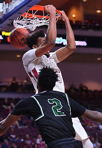 LAS VEGAS, NV - MARCH 08:  Johnny McCants #35 of the New Mexico State Aggies dunks against Jelani Pruitt #2 of the Chicago State Cougars during a quarterfinal game of the Western Athletic Conference basketball tournament at the Orleans Arena in Las Vegas, Nevada. The Aggies won 97-70.
