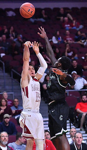 LAS VEGAS, NV - MARCH 08:  Joe Garza #15 of the New Mexico State Aggies shoots against Fred Sims Jr. #14 of the Chicago State Cougars during a quarterfinal game of the Western Athletic Conference basketball tournament at the Orleans Arena in Las Vegas, Nevada. The Aggies won 97-70.