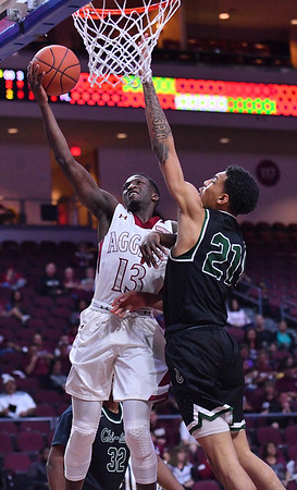LAS VEGAS, NV - MARCH 08:  Sidy N'Dir #13 of the New Mexico State Aggies drives in for a layup against Cameron Bowles #21 of the Chicago State Cougars during a quarterfinal game of the Western Athletic Conference basketball tournament at the Orleans Arena in Las Vegas, Nevada. The Aggies won 97-70.