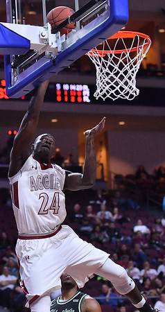 LAS VEGAS, NV - MARCH 08:  Leston Gordon #24 of the New Mexico State Aggies gets a layup against the Chicago State Cougars during a quarterfinal game of the Western Athletic Conference basketball tournament at the Orleans Arena in Las Vegas, Nevada. The Aggies won 97-70.