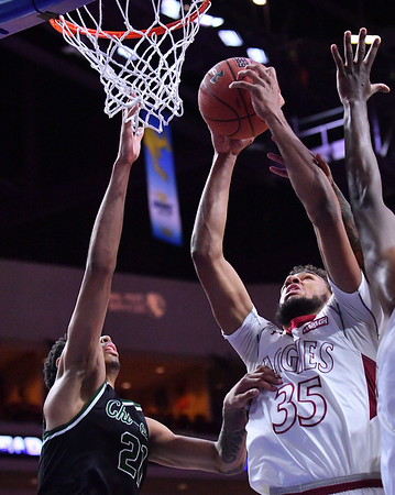 LAS VEGAS, NV - MARCH 08:  Johnny McCants #35 of the New Mexico State Aggies grabs a rebound against Cameron Bowles #21 of the Chicago State Cougars during a quarterfinal game of the Western Athletic Conference basketball tournament at the Orleans Arena in Las Vegas, Nevada. The Aggies won 97-70.