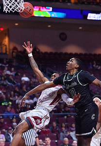 LAS VEGAS, NV - MARCH 08:  A.J. Harris #12 of the New Mexico State Aggies is fouled by Anthony Harris #10 of the Chicago State Cougars during a quarterfinal game of the Western Athletic Conference basketball tournament at the Orleans Arena in Las Vegas, Nevada. The Aggies won 97-70.