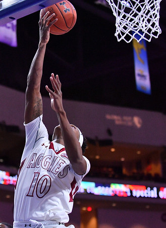 LAS VEGAS, NV - MARCH 08:  Jemerrio Jones #10 of the New Mexico State Aggies gets a layup against the Chicago State Cougars during a quarterfinal game of the Western Athletic Conference basketball tournament at the Orleans Arena in Las Vegas, Nevada. The Aggies won 97-70.