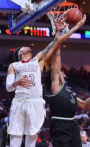 LAS VEGAS, NV - MARCH 08:  Eli Chuha #22 of the New Mexico State Aggies is fouled by Deionte Simmons #3 of the Chicago State Cougars during a quarterfinal game of the Western Athletic Conference basketball tournament at the Orleans Arena in Las Vegas, Nevada. The Aggies won 97-70.