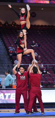 LAS VEGAS, NV - MARCH 08:  New Mexico State Aggies cheerleaders perform during halftime of the team's quarterfinal game of the Western Athletic Conference basketball tournament against the Chicago State Cougars  at the Orleans Arena in Las Vegas, Nevada. The Aggies won 97-70.