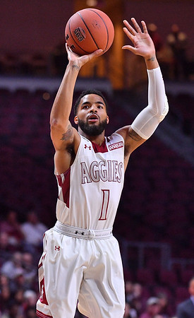 LAS VEGAS, NV - MARCH 08:  Shunn Buchanan #1 of the New Mexico State Aggies shoots against the Chicago State Cougars during a quarterfinal game of the Western Athletic Conference basketball tournament at the Orleans Arena in Las Vegas, Nevada. The Aggies won 97-70.