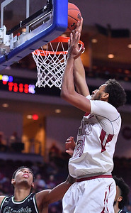 LAS VEGAS, NV - MARCH 08:  Johnny McCants #35 of the New Mexico State Aggies gets a layup against Cameron Bowles #21 of the Chicago State Cougars during a quarterfinal game of the Western Athletic Conference basketball tournament at the Orleans Arena in Las Vegas, Nevada. The Aggies won 97-70.