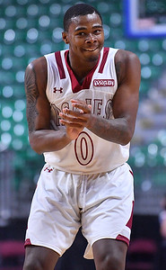 LAS VEGAS, NV - MARCH 08:  Keyon Jones #0 of the New Mexico State Aggies celebrates after hitting a three-pointer against the Chicago State Cougars during a quarterfinal game of the Western Athletic Conference basketball tournament at the Orleans Arena in Las Vegas, Nevada. The Aggies won 97-70.