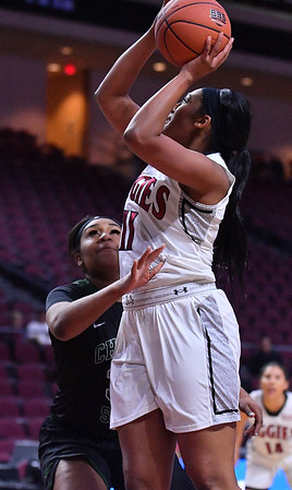 LAS VEGAS, NV - MARCH 07:  Baylee Robinson #11 of the New Mexico State Aggies goes up for a layup against Tamara Olverson #34 of the Chicago State Cougars during a quarterfinal game of the Western Athletic Conference basketball tournament at the Orleans Arena in Las Vegas, Nevada. The Aggies won 84-60.