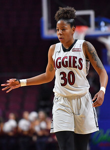 LAS VEGAS, NV - MARCH 07:  Gia Pack #30 of the New Mexico State Aggies gestures after hitting a three-pointer against the Chicago State Cougars during a quarterfinal game of the Western Athletic Conference basketball tournament at the Orleans Arena in Las Vegas, Nevada. The Aggies won 84-60.