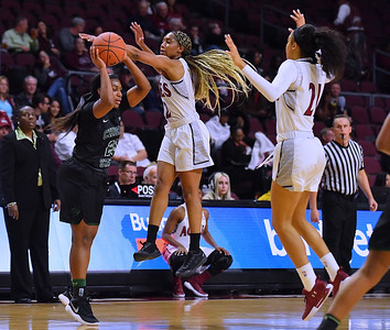 LAS VEGAS, NV - MARCH 07:  Zaire Williams #12 and Monique Mills #21 of the New Mexico State Aggies defend Destiny Harris #25 of the Chicago State Cougars during a quarterfinal game of the Western Athletic Conference basketball tournament at the Orleans Arena in Las Vegas, Nevada. The Aggies won 84-60.