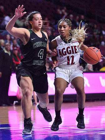 LAS VEGAS, NV - MARCH 07:  Zaire Williams #12 of the New Mexico State Aggies drives against Alexandria Cliff #4 of the Chicago State Cougars during a quarterfinal game of the Western Athletic Conference basketball tournament at the Orleans Arena in Las Vegas, Nevada. The Aggies won 84-60.
