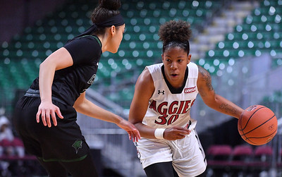 LAS VEGAS, NV - MARCH 07:  Gia Pack #30 of the New Mexico State Aggies drives against Tiana Thomas #12 of the Chicago State Cougars during a quarterfinal game of the Western Athletic Conference basketball tournament at the Orleans Arena in Las Vegas, Nevada. The Aggies won 84-60.