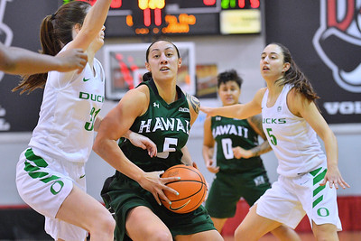 Dec 22, 2017; Las Vegas, NV, USA;  Hawai'i Rainbow Wahine guard Sarah Toeaina (5) drives against Oregon Ducks guard Aina Ayuso (31) during the Duel In The Desert at the Cox Pavilion in Las Vegas, Nevada.  Photo by Sam Wasson for Hawai'i Athletics