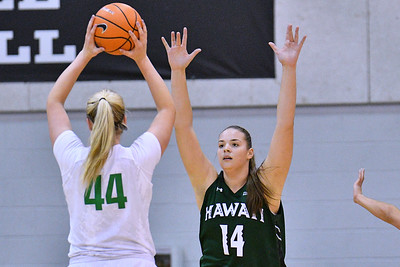 Dec 22, 2017; Las Vegas, NV, USA;  Hawai'i Rainbow Wahine center Lauren Rewers (14) defends Oregon Ducks forward Mallory McGwire (44) during the Duel In The Desert at the Cox Pavilion in Las Vegas, Nevada.  Photo by Sam Wasson for Hawai'i Athletics