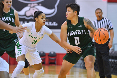 Dec 22, 2017; Las Vegas, NV, USA;  Hawai'i Rainbow Wahine guard Julissa Tago (0) looks to drive against Oregon Ducks guard Justine Hall (3) during the Duel In The Desert at the Cox Pavilion in Las Vegas, Nevada.  Photo by Sam Wasson for Hawai'i Athletics