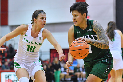 Dec 22, 2017; Las Vegas, NV, USA;  Hawai'i Rainbow Wahine guard Julissa Tago (0) drives against Oregon Ducks guard Lexi Bando (10) during the Duel In The Desert at the Cox Pavilion in Las Vegas, Nevada.  Photo by Sam Wasson for Hawai'i Athletics