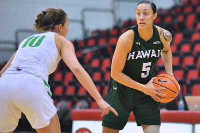 Dec 22, 2017; Las Vegas, NV, USA;  Hawai'i Rainbow Wahine guard Sarah Toeaina (5) looks to drive against Oregon Ducks guard Lexi Bando (10) during the Duel In The Desert at the Cox Pavilion in Las Vegas, Nevada.  Photo by Sam Wasson for Hawai'i Athletics