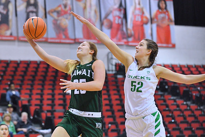 Dec 22, 2017; Las Vegas, NV, USA;  Hawai'i Rainbow Wahine forward Amy Atwell (25) drives in for a layup against Oregon Ducks forward Sierra Campisano (52) during the Duel In The Desert at the Cox Pavilion in Las Vegas, Nevada.  Photo by Sam Wasson for Hawai'i Athletics
