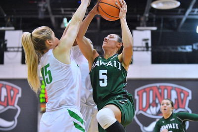 Dec 22, 2017; Las Vegas, NV, USA;  Hawai'i Rainbow Wahine guard Sarah Toeaina (5) drives in for a shot against Oregon Ducks guard Anneli Maley (15) during the Duel In The Desert at the Cox Pavilion in Las Vegas, Nevada.  Photo by Sam Wasson for Hawai'i Athletics