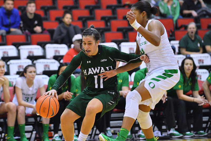 Dec 22, 2017; Las Vegas, NV, USA;  Hawai'i Rainbow Wahine guard Tia Kanoa (11) drives against Oregon Ducks forward Oti Gildon (32) during the Duel In The Desert at the Cox Pavilion in Las Vegas, Nevada.  Photo by Sam Wasson for Hawai'i Athletics
