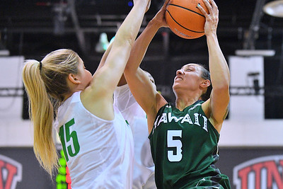 Dec 22, 2017; Las Vegas, NV, USA;  Hawai'i Rainbow Wahine guard Sarah Toeaina (5) shoots against Oregon Ducks guard Anneli Maley (15) during the Duel In The Desert at the Cox Pavilion in Las Vegas, Nevada.  Photo by Sam Wasson for Hawai'i Athletics