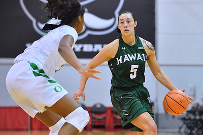 Dec 22, 2017; Las Vegas, NV, USA;  Hawai'i Rainbow Wahine guard Sarah Toeaina (5) drives against Oregon Ducks forward Ruthy Hebard (24) during the Duel In The Desert at the Cox Pavilion in Las Vegas, Nevada.  Photo by Sam Wasson for Hawai'i Athletics