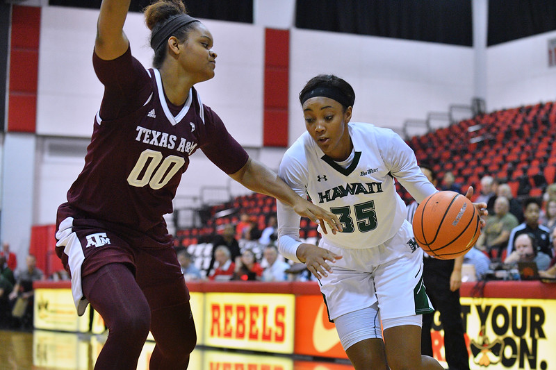 Dec 20, 2017; Las Vegas, NV, USA;  Hawaii Rainbow Wahine forward Makenna Woodfolk #35 drives against Texas A&M Aggies center Khaalia Hillsman #00 during the Duel In The Desert at the Cox Pavilion in Las Vegas, Nevada.  Photo by Sam Wasson for Hawai'i Athletics