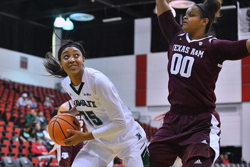 Dec 20, 2017; Las Vegas, NV, USA;  Hawai'i Rainbow Wahine forward Makenna Woodfolk (35) looks to shoot against Texas A&M Aggies center Khaalia Hillsman (00) during the Duel In The Desert at the Cox Pavilion in Las Vegas, Nevada.  Photo by Sam Wasson for Hawai'i Athletics