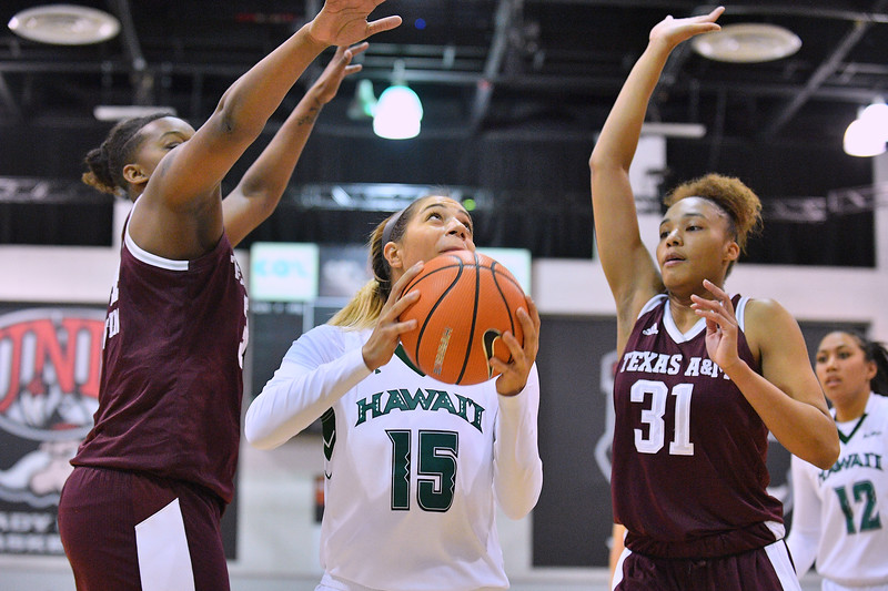 Dec 20, 2017; Las Vegas, NV, USA;  Hawai'i Rainbow Wahine guard Jadynn Alexander (15) looks to shoot against Texas A&M Aggies forward N'dea Jones (31) and Texas A&M Aggies forward Caylinne Martin (34) during the Duel In The Desert at the Cox Pavilion in Las Vegas, Nevada.  Photo by Sam Wasson for Hawai'i Athletics