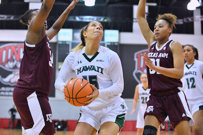 Dec 20, 2017; Las Vegas, NV, USA;  Hawaii Rainbow Wahine guard Jadynn Alexander #15 looks to shoot against Texas A&M Aggies forward Caylinne Martin #34 and Texas A&M Aggies forward N'dea Jones #31 during the Duel In The Desert at the Cox Pavilion in Las Vegas, Nevada.  Photo by Sam Wasson for Hawai'i Athletics