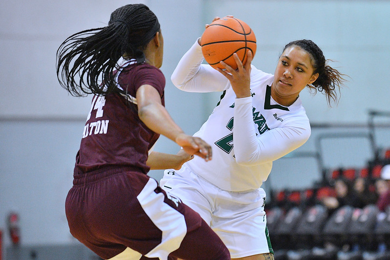 Dec 20, 2017; Las Vegas, NV, USA;  Hawai'i Rainbow Wahine forward Lahni Salanoa (21) looks to pass against Texas A&M Aggies guard Jada Walton (14) during the Duel In The Desert at the Cox Pavilion in Las Vegas, Nevada.  Photo by Sam Wasson for Hawai'i Athletics