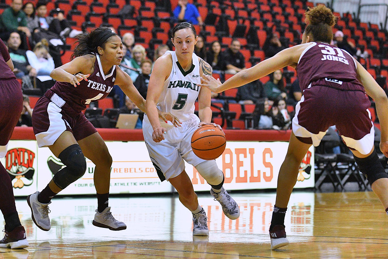 Dec 20, 2017; Las Vegas, NV, USA;  Hawai'i Rainbow Wahine guard Sarah Toeaina (5) drives against Texas A&M Aggies guard Lulu McKinney (4) and Texas A&M Aggies forward N'dea Jones (31) during the Duel In The Desert at the Cox Pavilion in Las Vegas, Nevada.  Photo by Sam Wasson for Hawai'i Athletics