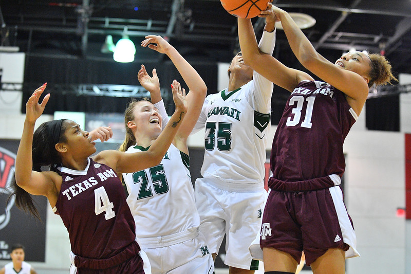 Dec 20, 2017; Las Vegas, NV, USA;  Hawai'i Rainbow Wahine forward Makenna Woodfolk (35) and Hawai'i Rainbow Wahine forward Amy Atwell (25) battle for a rebound against Texas A&M Aggies forward N'dea Jones (31) and Texas A&M Aggies guard Lulu McKinney (4) during the Duel In The Desert at the Cox Pavilion in Las Vegas, Nevada.  Photo by Sam Wasson for Hawai'i Athletics