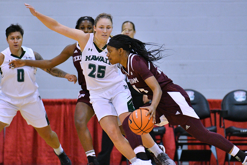 Dec 20, 2017; Las Vegas, NV, USA;  Hawai'i Rainbow Wahine forward Amy Atwell (25) defends against the Texas A&M Aggies during the Duel In The Desert at the Cox Pavilion in Las Vegas, Nevada.  Photo by Sam Wasson for Hawai'i Athletics