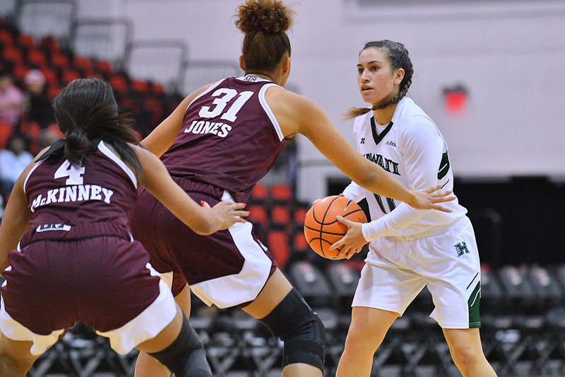 Dec 20, 2017; Las Vegas, NV, USA;  Hawai'i Rainbow Wahine guard Tia Kanoa (11) looks to drive against Texas A&M Aggies forward N'dea Jones (31) and Texas A&M Aggies guard Lulu McKinney (4) during the Duel In The Desert at the Cox Pavilion in Las Vegas, Nevada.  Photo by Sam Wasson for Hawai'i Athletics