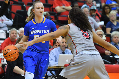 LAS VEGAS, NV - NOVEMBER 25:  Sandra Karsten #54 of the Hofstra Pride dribbles against Simone Sheppard #5 of the UNLV Rebels during the Lady Rebel Roundup at Cox Pavilion on November 25, 2017 in Las Vegas, Nevada.  (Photo by Sam Wasson for Hofstra)