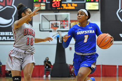 LAS VEGAS, NV - NOVEMBER 25:  E'Lexus Davis #1 of the Hofstra Pride drives against Nikki Wheatley #10 of the UNLV Rebels during the Lady Rebel Roundup at Cox Pavilion on November 25, 2017 in Las Vegas, Nevada.  (Photo by Sam Wasson for Hofstra)