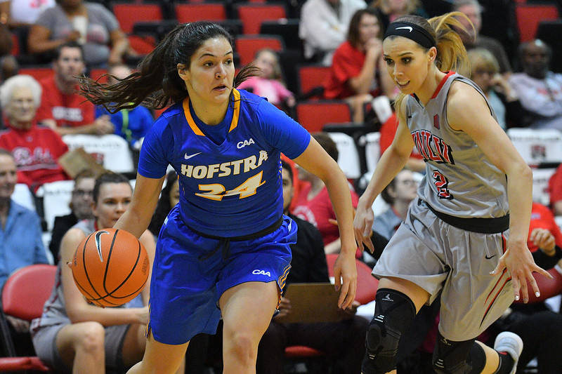 LAS VEGAS, NV - NOVEMBER 25:  Sica Cuzic #24 of the Hofstra Pride drives against Brooke Johnson #2 of the UNLV Rebels during the Lady Rebel Roundup at Cox Pavilion on November 25, 2017 in Las Vegas, Nevada.  (Photo by Sam Wasson for Hofstra)