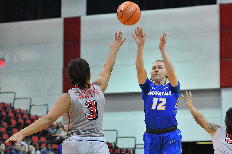 LAS VEGAS, NV - NOVEMBER 25:  Mie Hoff #12 of the Hofstra Pride shoots against Paris Strawther #3 of the UNLV Rebels during the Lady Rebel Roundup at Cox Pavilion on November 25, 2017 in Las Vegas, Nevada.  (Photo by Sam Wasson for Hofstra)