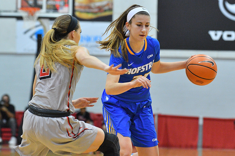 LAS VEGAS, NV - NOVEMBER 25:  Olivia Askin #22 of the Hofstra Pride drives against Brooke Johnson #2 of the UNLV Rebels during the Lady Rebel Roundup at Cox Pavilion on November 25, 2017 in Las Vegas, Nevada.  (Photo by Sam Wasson for Hofstra)