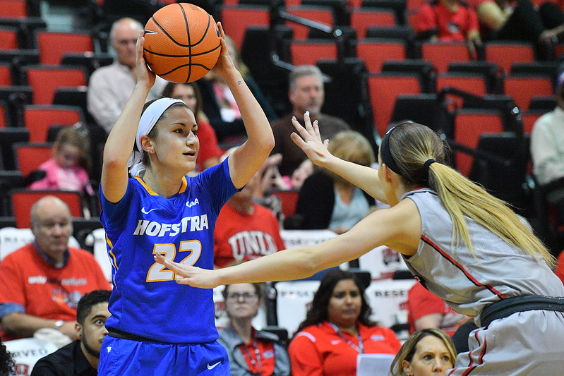 LAS VEGAS, NV - NOVEMBER 25:  Olivia Askin #22 of the Hofstra Pride looks to pass against Brooke Johnson #2 of the UNLV Rebels during the Lady Rebel Roundup at Cox Pavilion on November 25, 2017 in Las Vegas, Nevada.  (Photo by Sam Wasson for Hofstra)