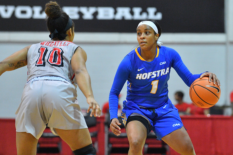 LAS VEGAS, NV - NOVEMBER 25:  E'Lexus Davis #1 of the Hofstra Pride dribbles against Nikki Wheatley #10 of the UNLV Rebels during the Lady Rebel Roundup at Cox Pavilion on November 25, 2017 in Las Vegas, Nevada.  (Photo by Sam Wasson for Hofstra)