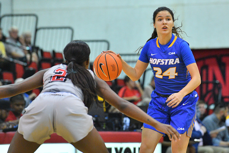 LAS VEGAS, NV - NOVEMBER 25:  Sica Cuzic #24 of the Hofstra Pride looks to drive against Rodjanae Wade #24 of the UNLV Rebels during the Lady Rebel Roundup at Cox Pavilion on November 25, 2017 in Las Vegas, Nevada.  (Photo by Sam Wasson for Hofstra)