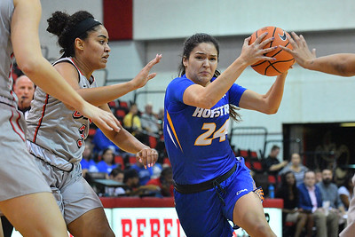 LAS VEGAS, NV - NOVEMBER 25:  Sica Cuzic #24 of the Hofstra Pride drives against Paris Strawther #3 of the UNLV Rebels during the Lady Rebel Roundup at Cox Pavilion on November 25, 2017 in Las Vegas, Nevada.  (Photo by Sam Wasson for Hofstra)