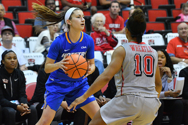 LAS VEGAS, NV - NOVEMBER 25:  Olivia Askin #22 of the Hofstra Pride looks to pass against Nikki Wheatley #10 of the UNLV Rebels during the Lady Rebel Roundup at Cox Pavilion on November 25, 2017 in Las Vegas, Nevada.  (Photo by Sam Wasson for Hofstra)
