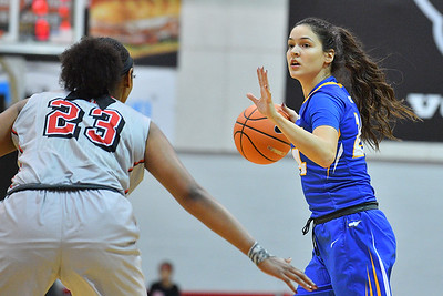 LAS VEGAS, NV - NOVEMBER 25:  Sica Cuzic #24 of the Hofstra Pride dribbles against Jordyn Bell #23 of the UNLV Rebels during the Lady Rebel Roundup at Cox Pavilion on November 25, 2017 in Las Vegas, Nevada.  (Photo by Sam Wasson for Hofstra)